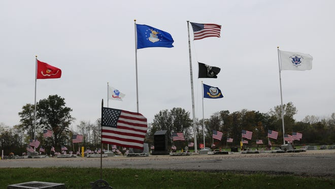 The American Legion Post 113 made improvements to the Veterans' Circle, replacing four-foot-tall flagpoles to ones that are 15 feet high, at Riverview Cemetery in Port Clinton.