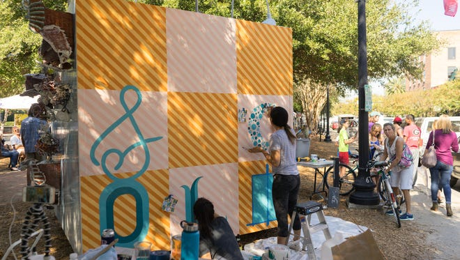 Artists Veronique Zayas, owner of HatchMark Studio in Pensacola, andSomi Choi, a lead designer with idgroup,created this CUBED art design last year.