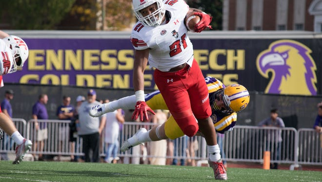 Austin Peay running back Ahmaad Tanner carries the ball against Tennessee Tech Saturday, November 4 in Cookeville, Tennessee.