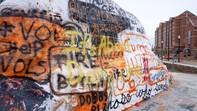 The famed rock at UT's Knoxville campus has already been painted with a sign referencing Butch Jones' exit from the Volunteers' football program.