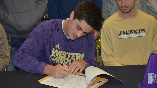 Hayesville High School senior Josh Cottrell signed a National Letter of Intent to attend Western Carolina University and play basketball for the Catamounts.