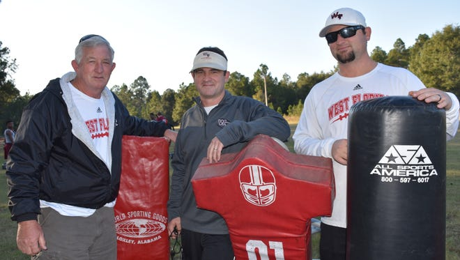 West Florida High head football coach Rhett Summerford (center) has a family staff with his brother Wes as offensive coordinator and father Neil as defensive backs coach for the Jaguars.
