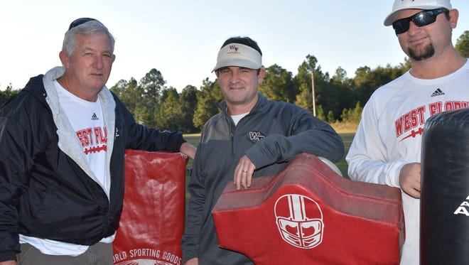 Wes Summerford (right) stands with father Neil (left) and West Florida head coach/ brother Rhett Summerford (center) during his time with the Jaguars. Wes Summerford began his head coaching tenure at Northview on Friday in an explosive win.