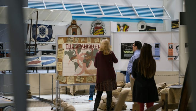 Pensacola State College graphic design students pay tribute to World War I in their senior project, a collaborative museum exhibit on display at the National Naval Aviation Museum in Pensacola.