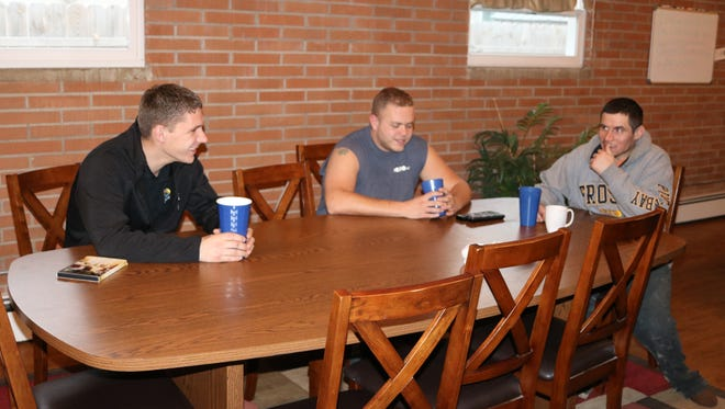 Kenn Bower, Seth O'Neal and Chris Lawson, recovering addicts at Light House Sober Living, discuss Thanksgiving plans.
