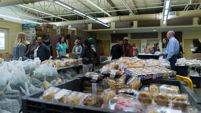A coalition of organizations like the University of Florida Institute of Food and Agricultural Science, Leonard & Susan Kichler Farm and Feeding the Gulf Coast distributed holiday meal boxes to 400 pre-registered Escambia County families on Tuesday, Nov. 21, 2017.