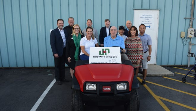 The staff of the First Tee of Northwest Florida, along with members of the Jerry Pate Company, gather in front of new Toro Workman vehicle awarded to the local chapter from Toro Company headquarters in Minneapolis. Pensacola was one of three First Tee chapters chosen.