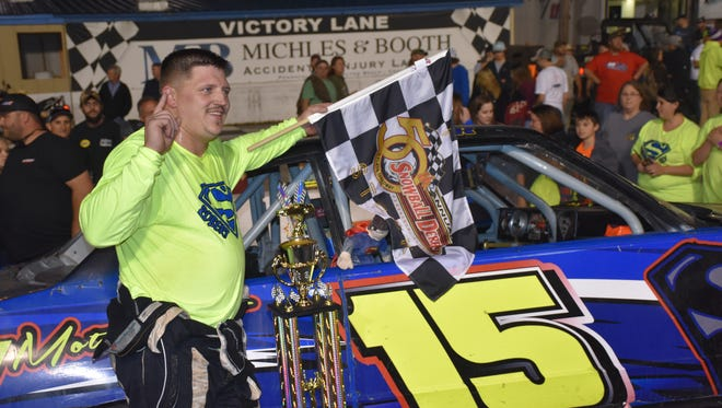 Robert Loper stands with his Pure Stock race machine as winner of Wednesday night's Pure Stock 50 Lap Feature that began the 50th Snowball Derby week at Five Flags Speedway.