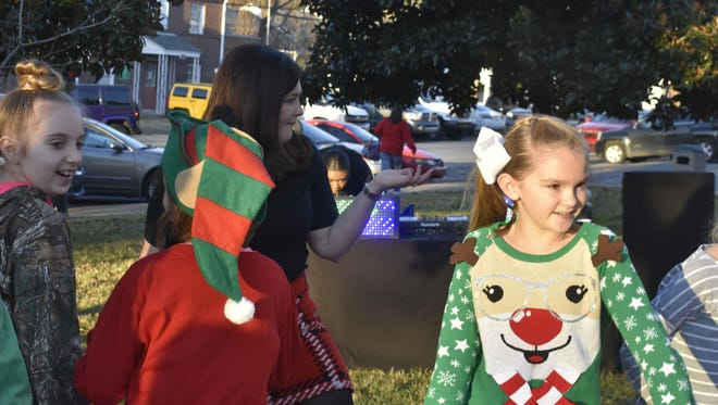 Valerie Kemp Dreier dances with attendees at the toy drive, which she organized on the Cheatham County Courthouse lawn on Dec. 2, complete with a DJ and refreshments.