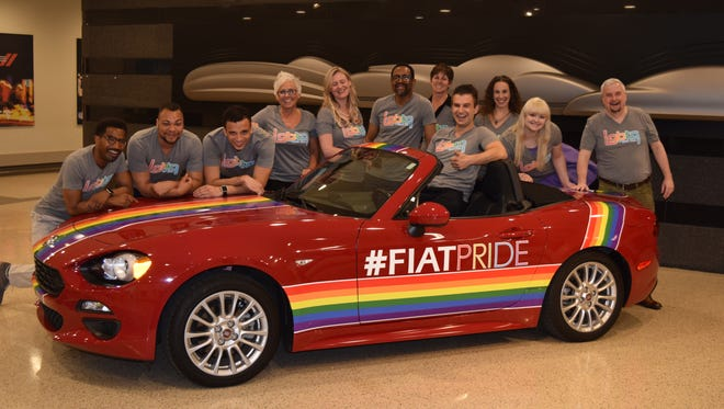 Members of the Gay and Lesbian Alliance at Fiat Chrysler Automobiles. Kelly Hanlon, fourth from left, is the chairperson of the group. The vehicle is a specially wrapped Fiat Spider that was provided as a lead vehicle in this year's Motor City Pride Parade in June.