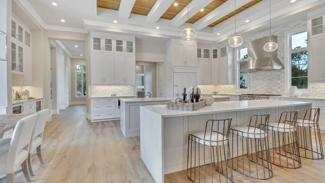 Stock's new Cristale model, located on a golf course home site in Quail West, features a double-island kitchen.