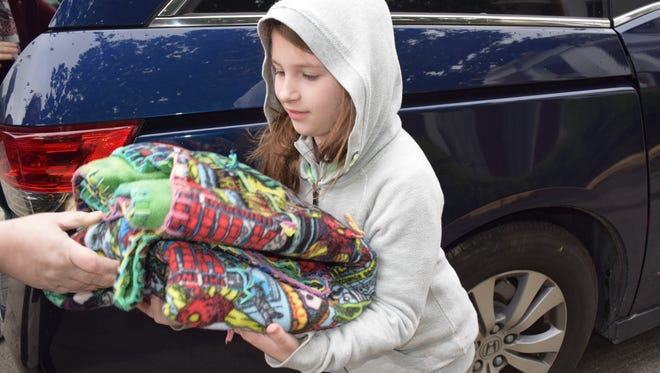 Addy Thayer drops off a blanket on Blanket Day on Dec. 9, 2017.