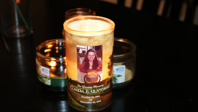 A memorial candle for Sheboygan Press editor Leah Ulatowski's mother, Claudia, who passed away in 2015.