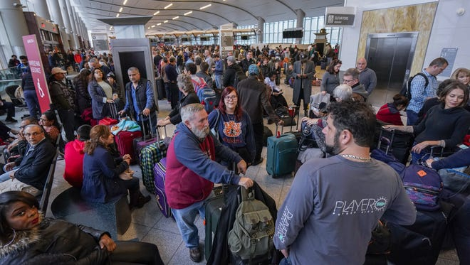 Passengers affected by a widespread power outage wait in long lines at the International Terminal of Hartsfield-Jackson Atlanta International Airport on Dec. 17, 2017.