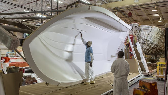 A Pursuit Boat employee paints a boat inside the new $2.1 million building in Fort Pierce. Pursuit Boats inked a deal with St. Lucie County on Tuesday to create 30 jobs and retain 376 jobs in exchange for $50,000 paid over two years and paying decreased property taxes for six years.
