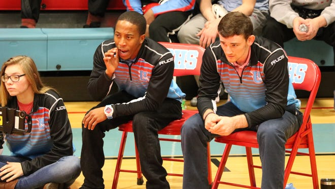 Jarvis Elam and John Fahy coach from the sidelines during the match.