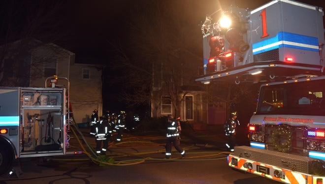 PFA crews fight a house fire that damaged two homes in early December.