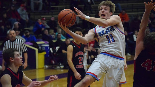 Logan Thomas drives to the hoop to score against the Lions Thursday in Eldorado.