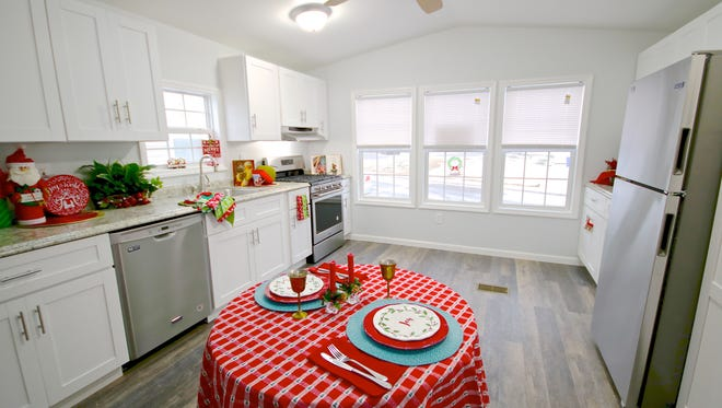 The kitchen in this two-bedroom home is spacious and bright, with full-size cabinets and a big window. This home is available for $65,000.