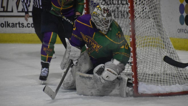 Ice Flyers goaltender Brian Billet watches the puck behind his goal during the third period Saturday against the Birmingham Bulls.