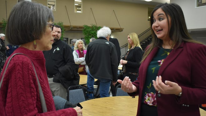 Lynn Busacca, left, asks Shelton City Council candidate Deidre Peterson a question during a candidate meet-and-greet sponsored by the Shelton-Mason County Chamber of Commerce, Tuesday, Jan. 16. Fifteen candidates are running for the four open seats.
