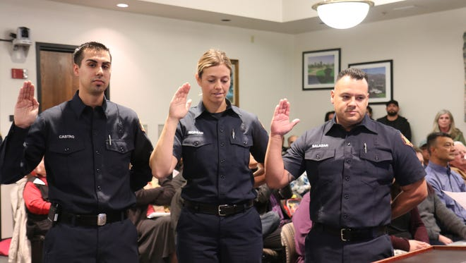 Jordan Castro, left, Clair Morgan and Mike Salazar are sworn in as the first full-time Fillmore firefighters.