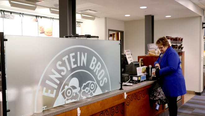 Dr. Kristine Harms, director of field services for DSU's College of Education, makes a purchase at Einstein's Bros. Bagels on the DSU campus recently. This location will be offering Caribou Coffee products beginning next week.