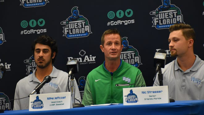 UWF baseball coach Mike Jeffcoat (center) discusses upcoming season with two of his seniors, second baseman Nic Strasser (right) and infielder-outfielder Nick Kerkmann.