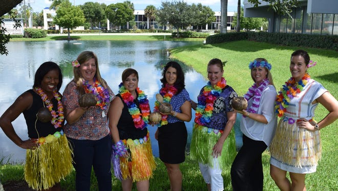 From left, Tikis on the Terrace planning committee includes Natalie Desmangles, Amy Bottegal, Rachel Terlizzi, Nancy McCarthy, Donna DeMarchi, Elisabeth Glynn and Maggie Henson.