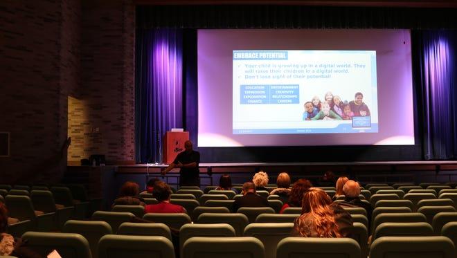 Scott Frank, a former internet crimes against children investigator, discusses internet safety for kids in a presentation at Port Clinton High School.