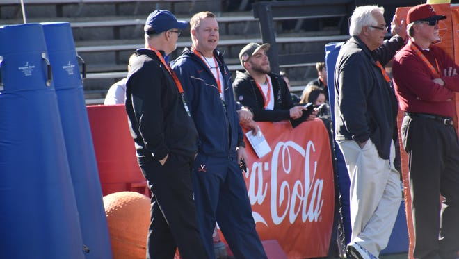 UWF coach Pete Shinnick and Virginia head coach Bronco Mendenhall visit Thursday as invited sideline guests at the Reese's Senior Bowl practices at Ladd-Peebles Stadium.