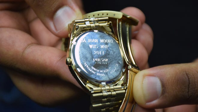 Waynesboro senior DaJuan Moore shows the inscription on the back of the gold watch he received from the Waynesboro Touchdown Club for being the Most Valuable Player on the high school's football team for the 2017 season.