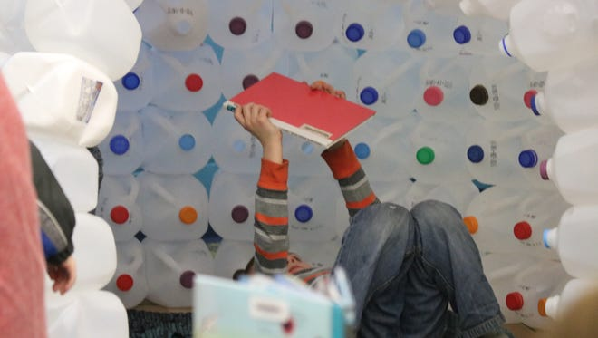 One of the highlights of the Winter Wonderland Family Night was a chance for students to read inside an indoor igloo that teachers made out of empty milk jugs.