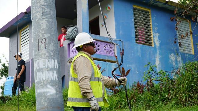 "Librado ""Sonny"" Acevedo, an APS crew foreman, works in Puerto Rico to restore power."