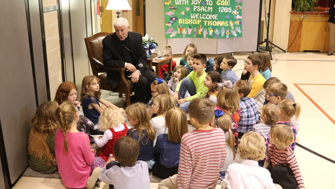 Bishop Daniel Thomas of the Toledo diocese answers questions from students at Immaculate Conception School.