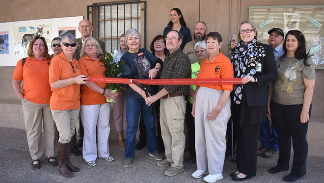 Docent Program Coordinator Loretta Diehl and Zoo Superintendent Bud Wiser cut the ribbon at the Alamogordo Chamber of Commerce's presentation Saturday.