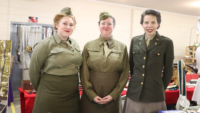 Katie Bitonti, Stephanie Nickols and Molly Cooper, of the 1st WAC Bn, portray members from the Women's Army Corps during the WWII era.