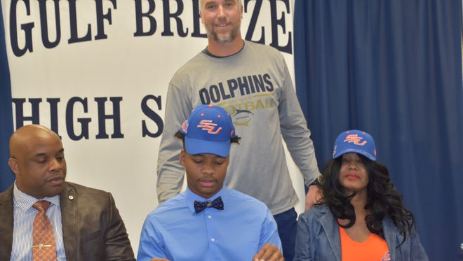 Gulf Breeze defensive back Walter Yates III signs with Savannah State on Wednesday at Gulf Breeze High.
