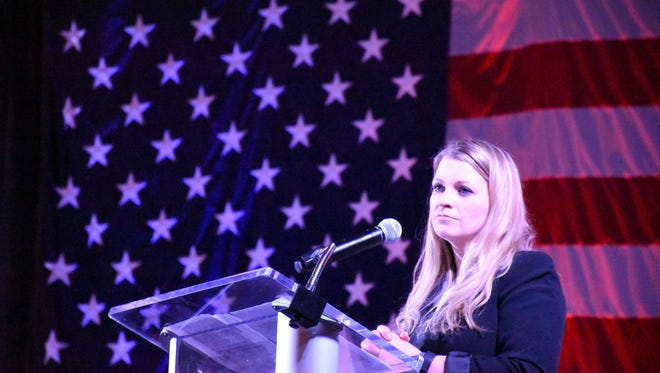 Jessica Lynch, a private first class who was held prisoner in Iraq in 2003, speaks during the 2018 Butterfly Ball hosted by Avow Hospice on Feb. 10, 2018 at Naples Municipal Airport.