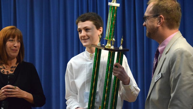 Leon County's Christopher Hays, 14, holds his trophy after winning the Big Bend Regional Spelling Bee on Saturday, Feb. 17.