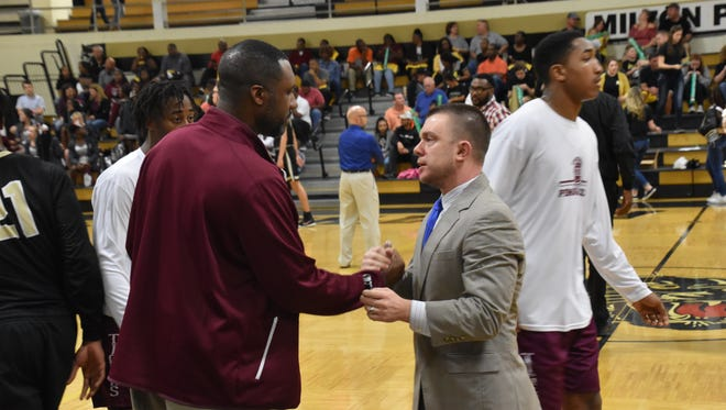 Pensacola High coach Terrence Harris, left, and Milton's Joey Murdock greet each other prior to tipoff in last year's District 1-7A Boys Basketball Tournament final at Milton.
