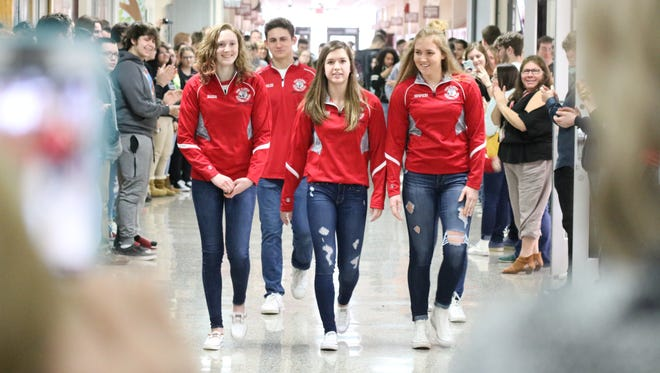 Port Clinton High School gives a proper send-off to their swimmers who will be competing at the state championship tournament this week.