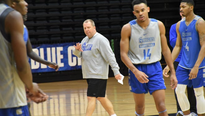 UWF basketball coach Jeff Burkhamer watches his team go through its practice Tuesday in preparation for Saturday's NCAA Division II Tournament game in Atlanta.