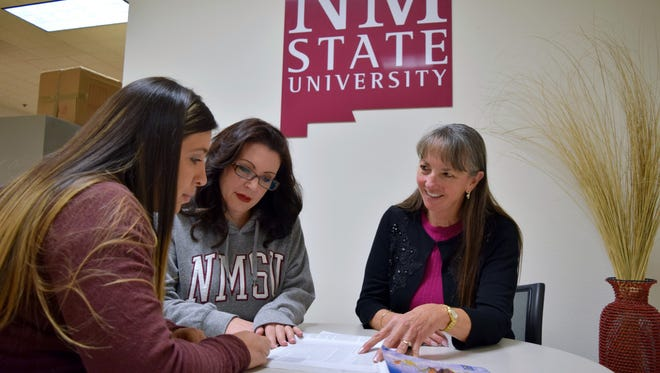 New Mexico State University Masters of Social Work student Ashley Bellon, left, listens to Anna Nelson, center, assistant professor in the School of Social Work and Sue Forster-Cox, professor in the Department of Public Health Sciences, as they explain the public health social work dual master's degree program.