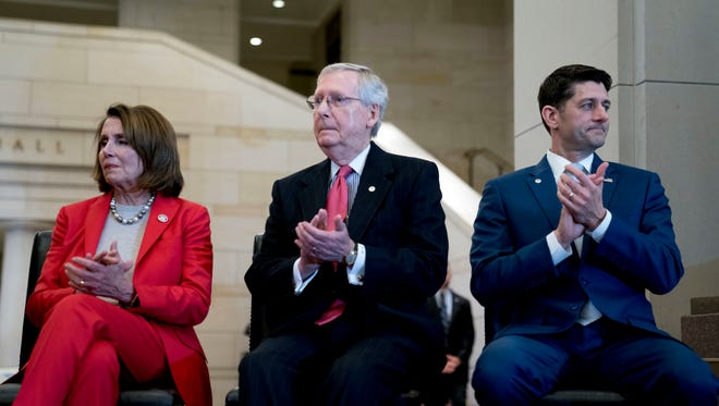 From left, House Minority Leader Nancy Pelosi of Calif., Senate Majority Leader Mitch McConnell of Ky., and House Speaker Paul Ryan of Wis., appear together on Capitol Hill in Washington, March 21, 2018.
