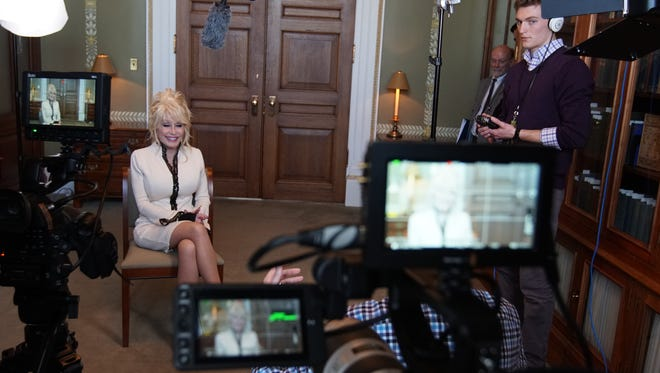 """University of Tennessee Students work on a Land Grant Films documentary """"100 Million Stories"""" in Washington D.C. where they interviewed Dolly Parton."""