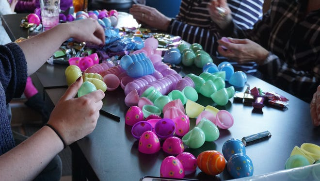 About 50 volunteers stuffed 20,000 eggs for Children's Charity of Greater Binghamton's Easter Egg Hunt on Saturday.