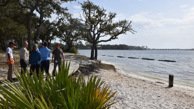 """Escambia County installed a """"living reef"""" of oyster shells in Bayou Grande to stop erosion and improve water quality at Navy Point Park. Some area residents are concerned the reefs will be harmful to children and families using the water, as well as damaging to the ecology."""