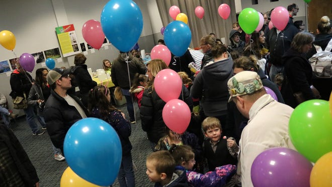 Balloons filled up the museum as children waited in line for face painting, games, story time and an egg decorating contest.