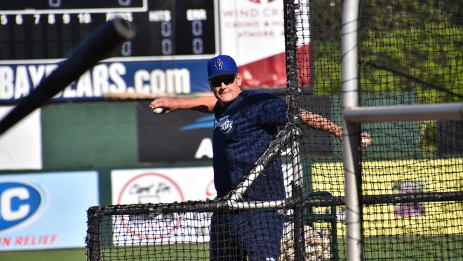 Blue Wahoos manager Jody Davis, making his team debut, throws batting practice Thursday at Hank Aaron Stadium in Mobile, prior to the Blue Wahoos game against the Bay Bears.